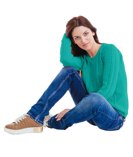 woman in sea green sweatshirt & jeans