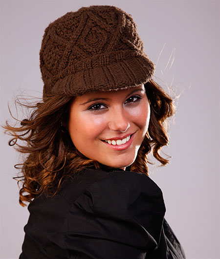 Girl wearing brown winter cape