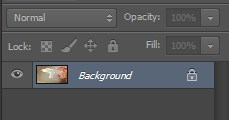 In Photoshop Background Layer is shown