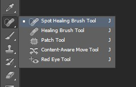 Selecting Spot Healing Brush Tool in Photoshop