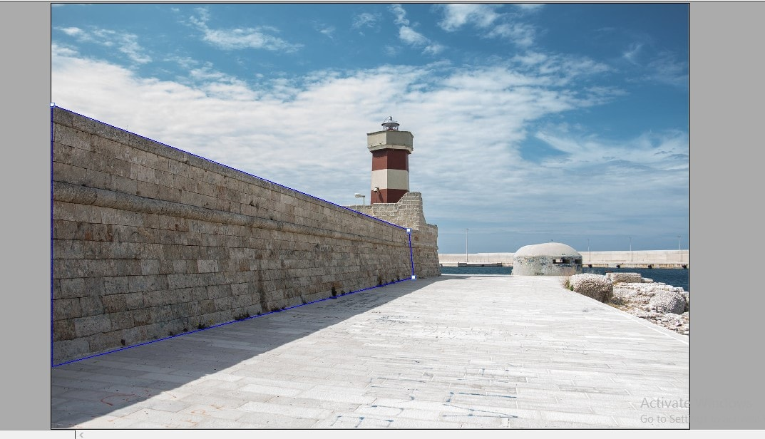 Make a selection of the wall using the vanishing point filter in Photoshop